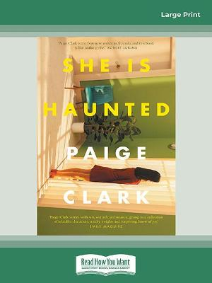 She Is Haunted by Paige Clark